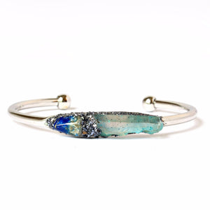 natural lapis lazuli and aqua aura quartz bracelet on white background