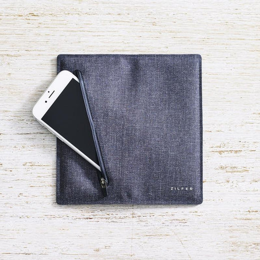Zilfer Phone Wallet In Grey Open Rear With White iPhone Going Into Pocket On Light Wood Desk