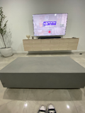 Floating concrete coffee table