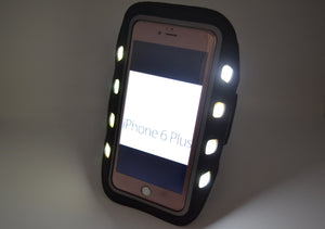 Lit up armband device holder with phone in