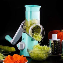 Mandolin slicer in blue color slices nutritious vegetables