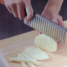 Cutting potato with a potato slicer for making fry chips