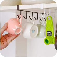 Mugs rests on hanging hook shelf dish