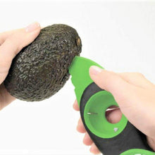 Avocdo slicer cuts in half the avocado