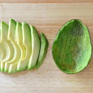 Avocado is sliced for equal slices