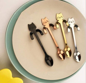 4  Colourful Cartoon Cat Teaspoons on the plate