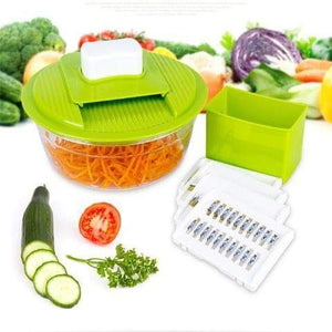 Multi Kitchen Slicer Is Slicing Carrots, Cucmbers And Tomatoes