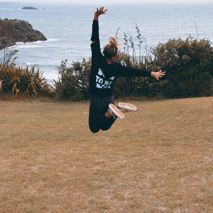 Kate jumps for joy in Bold's Born to be Bold sequin hoodie in New Plymouth New Zealand  | #sayitinbold @boldornaked shop online at www.boldornaked.com