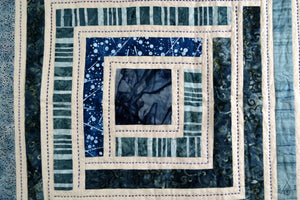 campfire baby quilt: blue batiks and osnaburg fabric