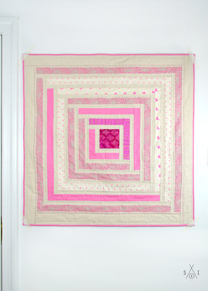 campfire baby quilt: pink and osnaburg fabric