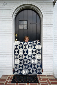 quarter square triangle baby quilt: ombre and blue batik