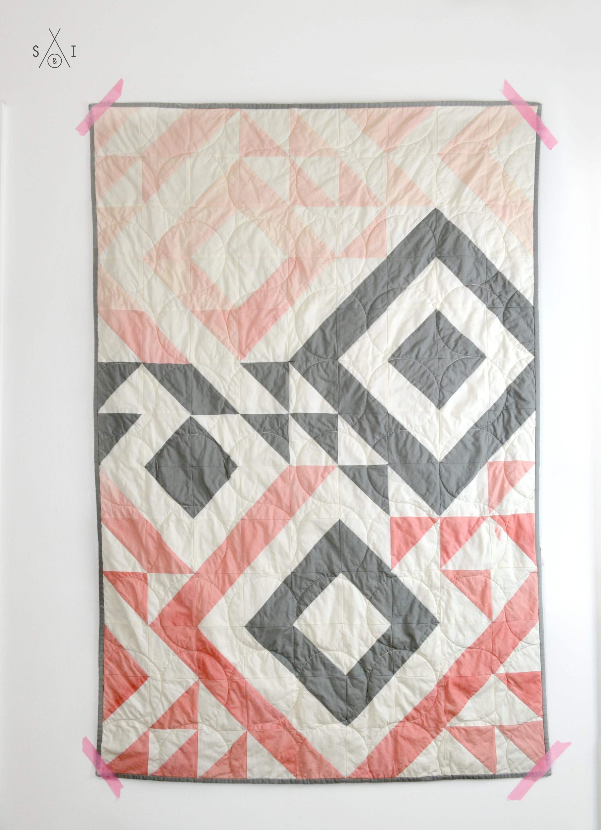 Triangle Jitters half square triangles baby quilt: ombre pink and gray