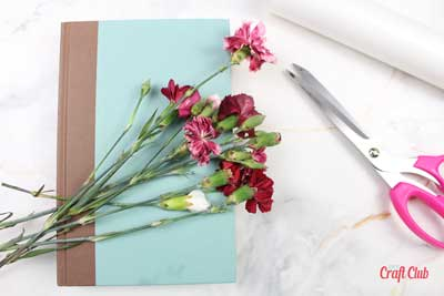 how to dry flowers inside books