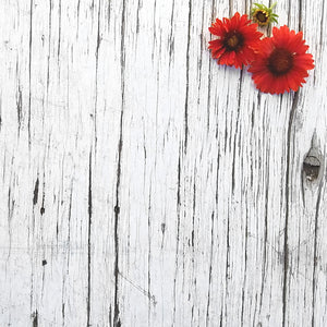 red flowers on wooden background