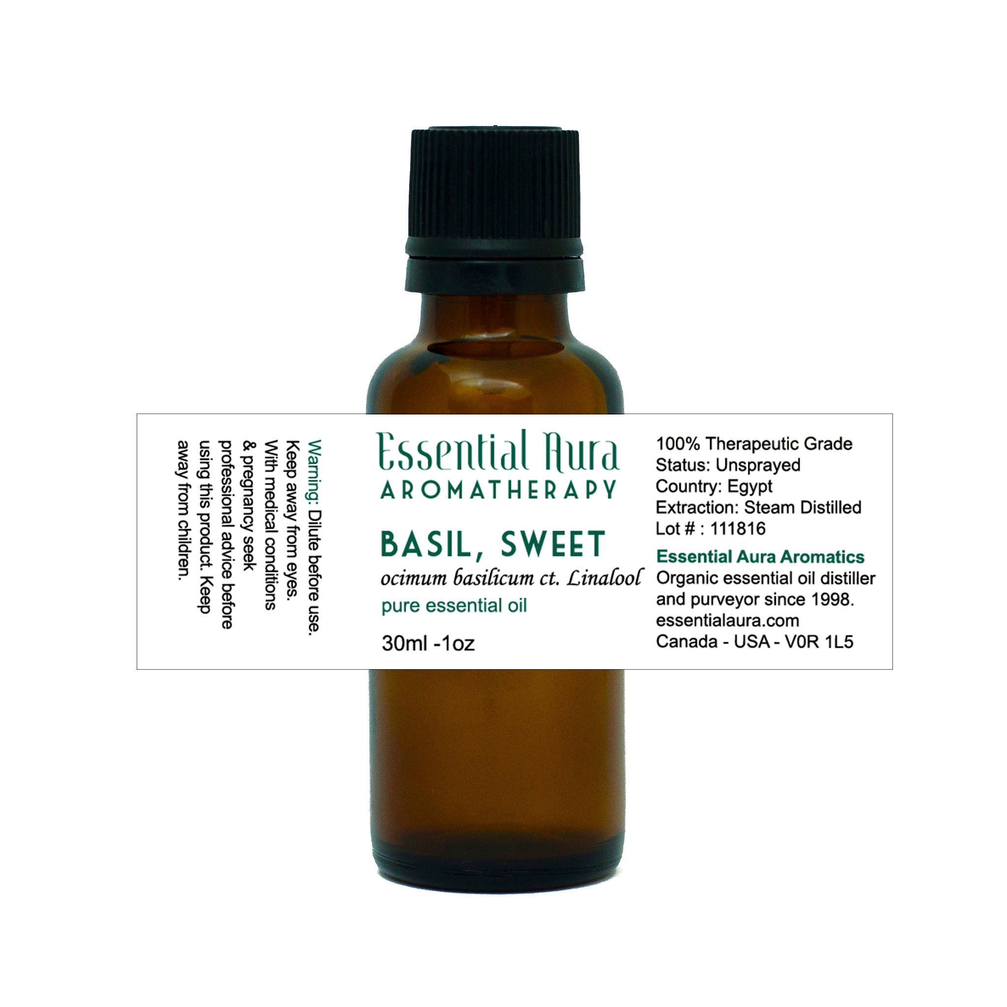bottle of basil essential oil