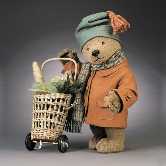 Name: Paddington Goes To Market™ Outfit Description: Fully-lined felt overcoat with leather buttons, felt hat, and Scottish wool scarf. Includes custom-made wicker market cart with metal and rubber wheels.