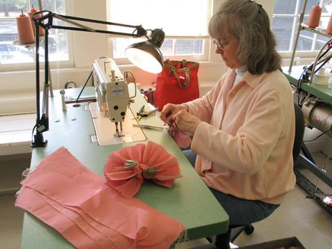 Red Clover Fairy dresses being sewn during production