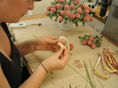 The all-felt clover blossoms are carefully constructed by hand during production