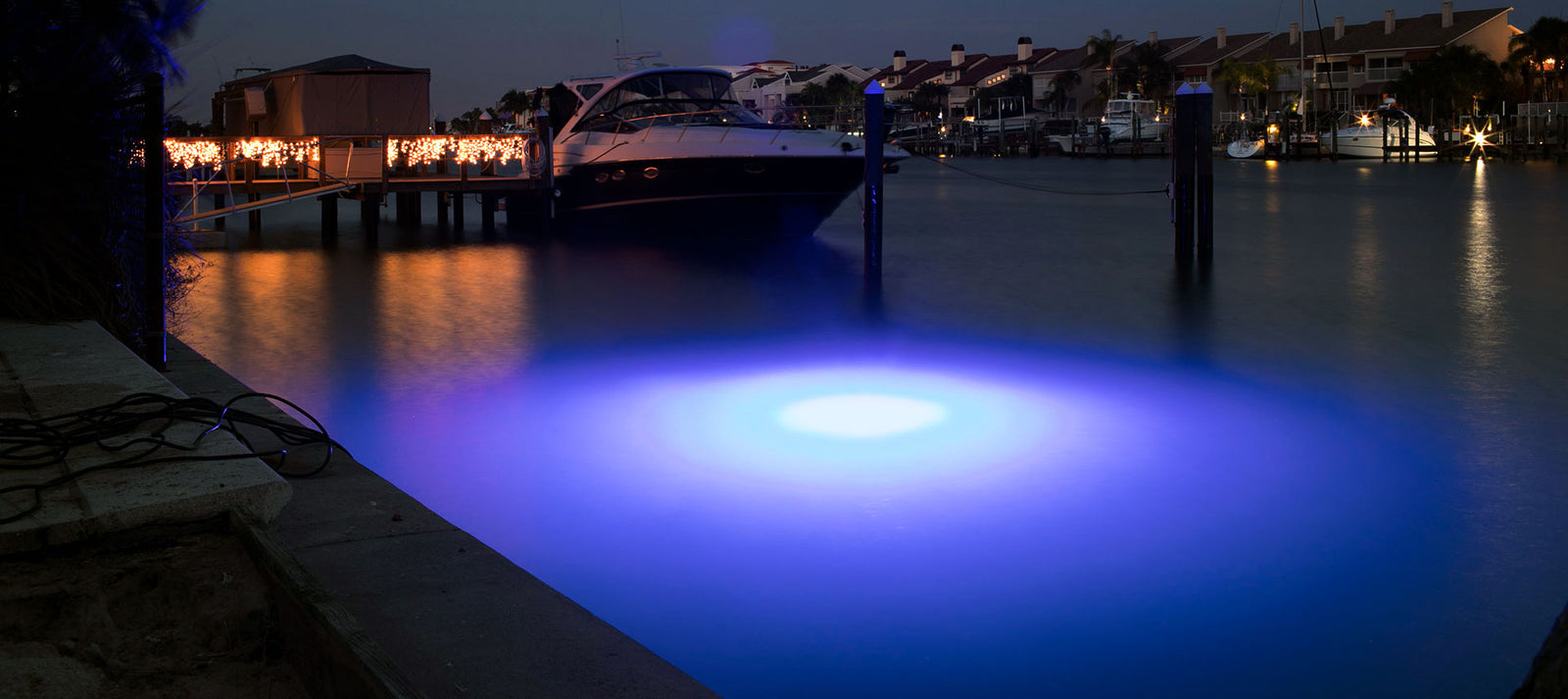 Underwater Blue Dock Light Illuminating a Boat during the night. Brightest LED Dock light available