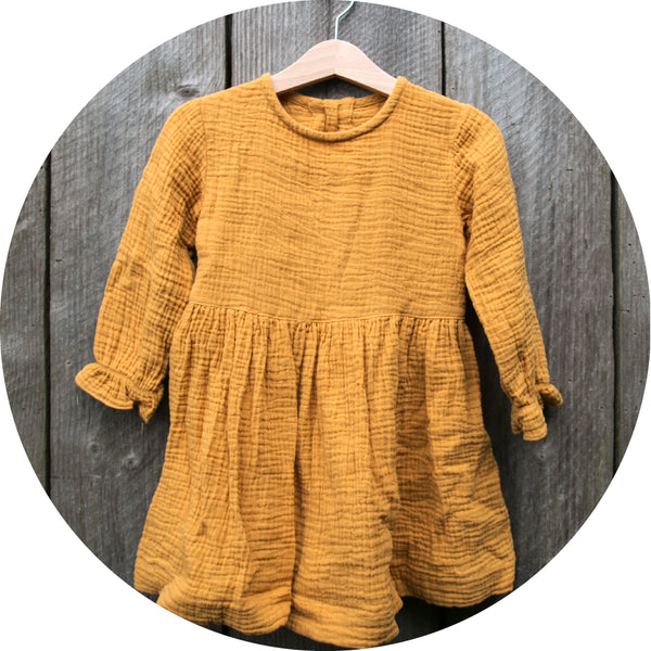 Dress in mustard yellow