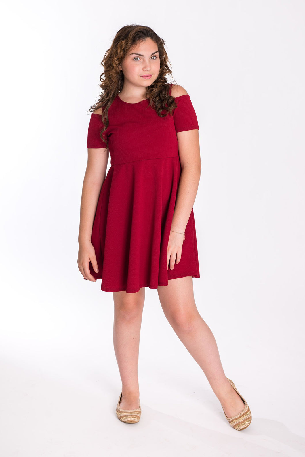 Young girl wearing this kids plus size Cold Shoulder Textured Skater Dress in Red With Necklace, perfect for holidays!