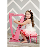 Girl playing Schoenhut 15-String Harp w/ Bench Pink