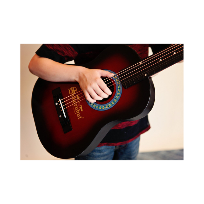 Boy playing Schoenhut Acoustic Guitar Red/Black