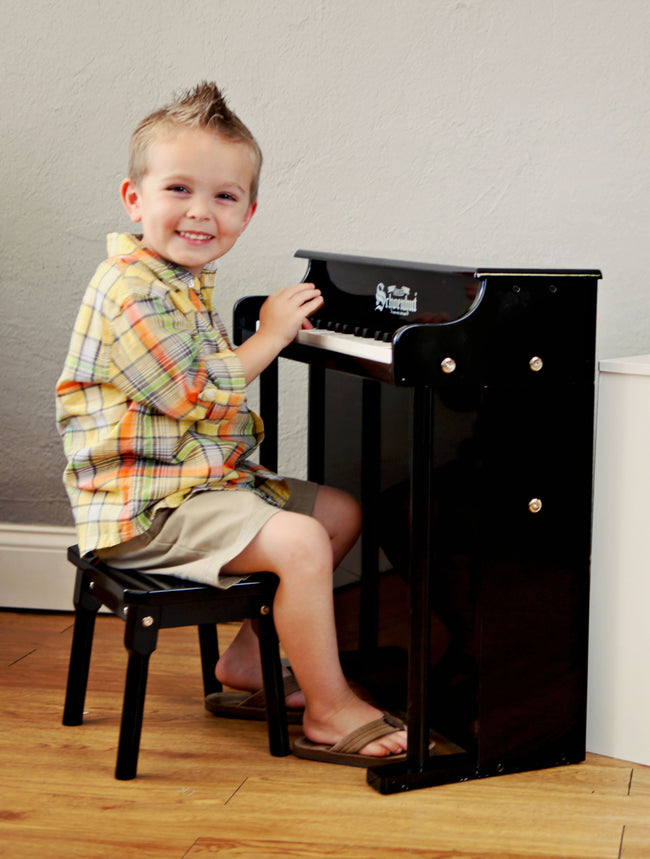 Child with Schoenhut Traditional Deluxe Spinet Piano 37-Key Black