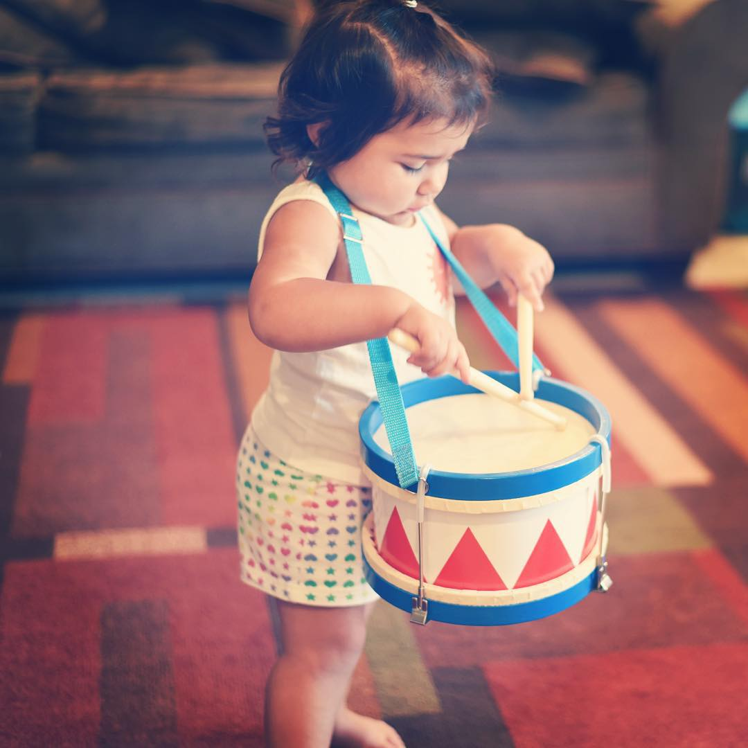 Child with Schoenhut Tunable Drum