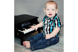 Child with Schoenhut Mini Grand Piano 18-Key Black
