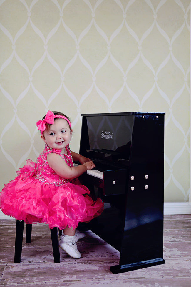 Girl playing Schoenhut Day Care Durable Piano 37-Key Black
