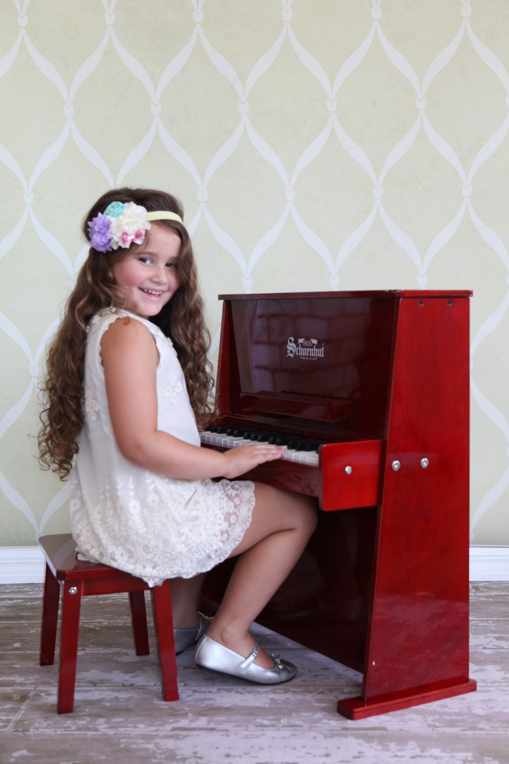 Girl playing Schoenhut Day Care Durable Piano 37-Key Mahogany