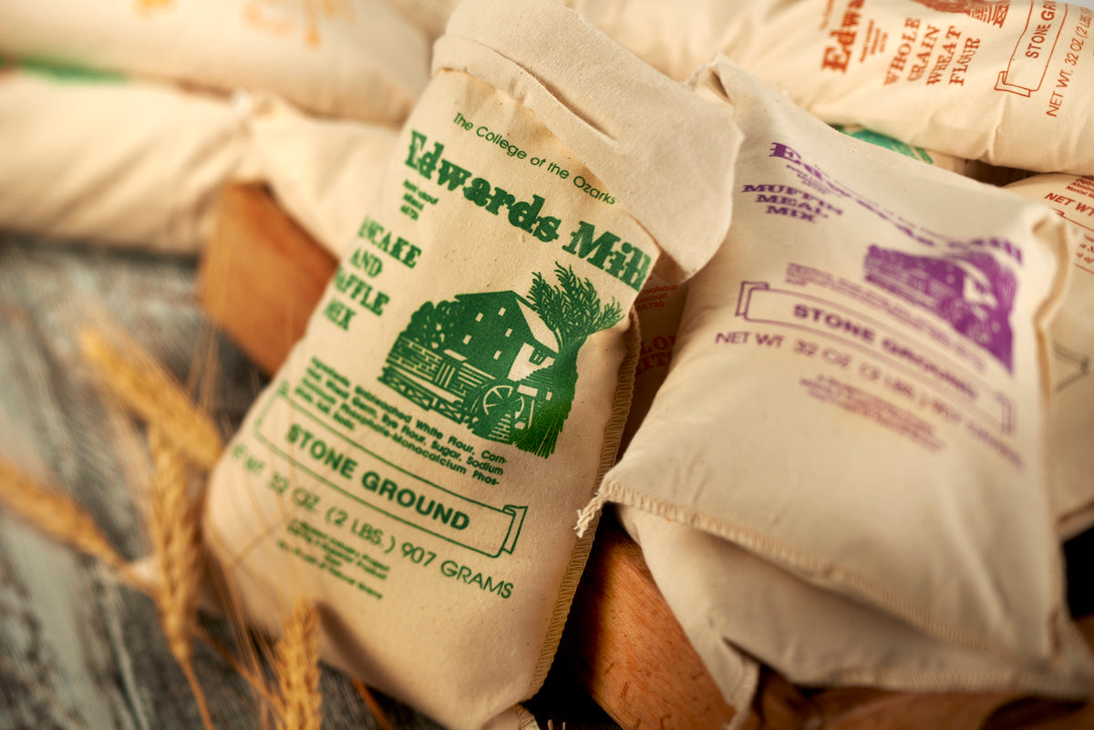 Bags of Edwards Mill stone ground pancake and muffin mix