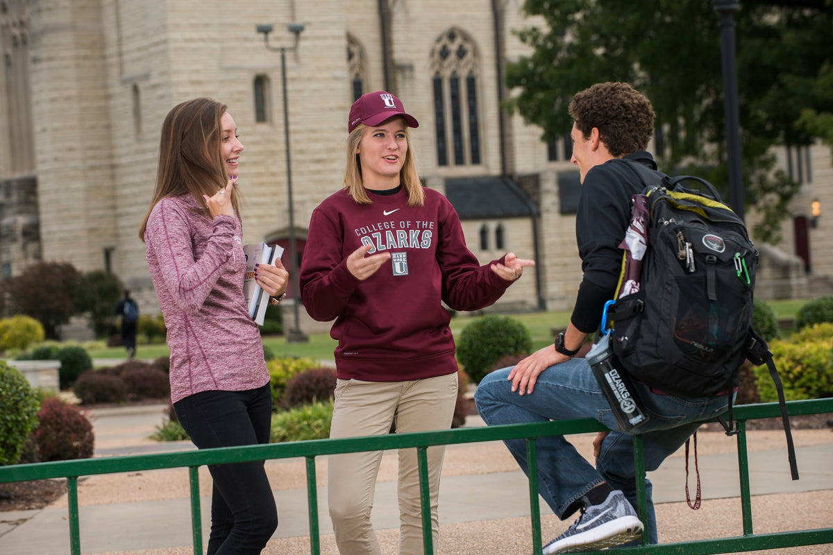 Three students wearing College of the Ozarks clothes