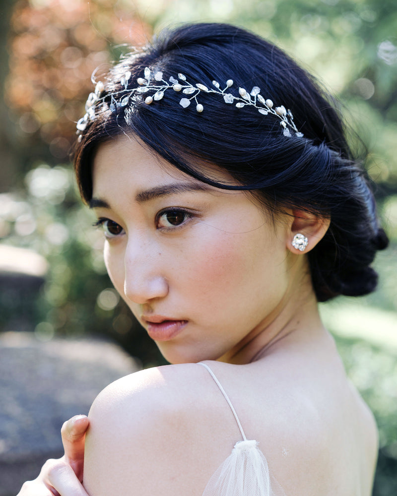 Model wearing Moonflower bridal hair vine in silver with rose quarts and swarovski crystals