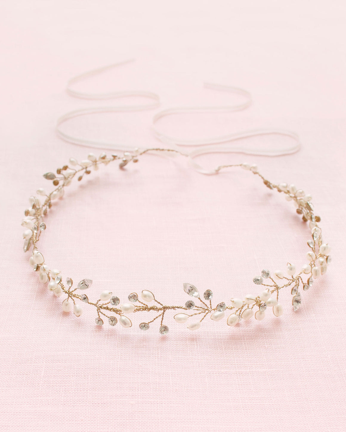 A delicate gold hair vine of Swarovski crystals and pearl clusters.