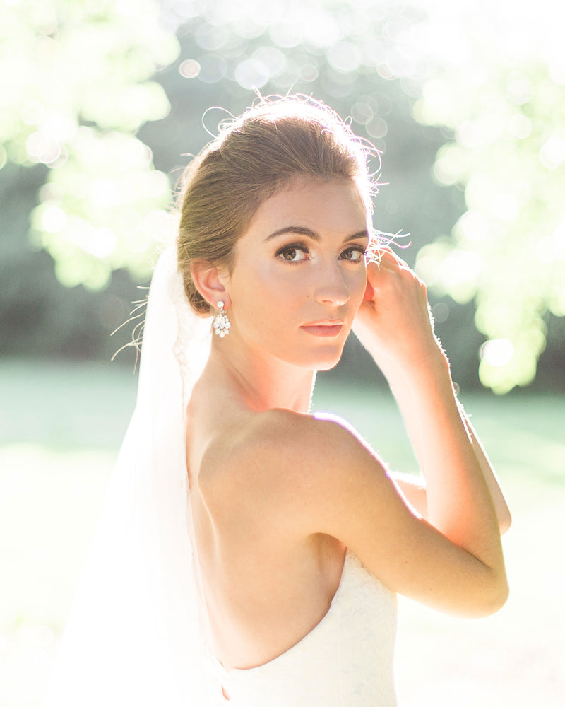 model wearing petite crystal wedding drop earrings in silver
