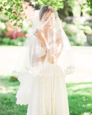 model wearing double layer alencon lace veil
