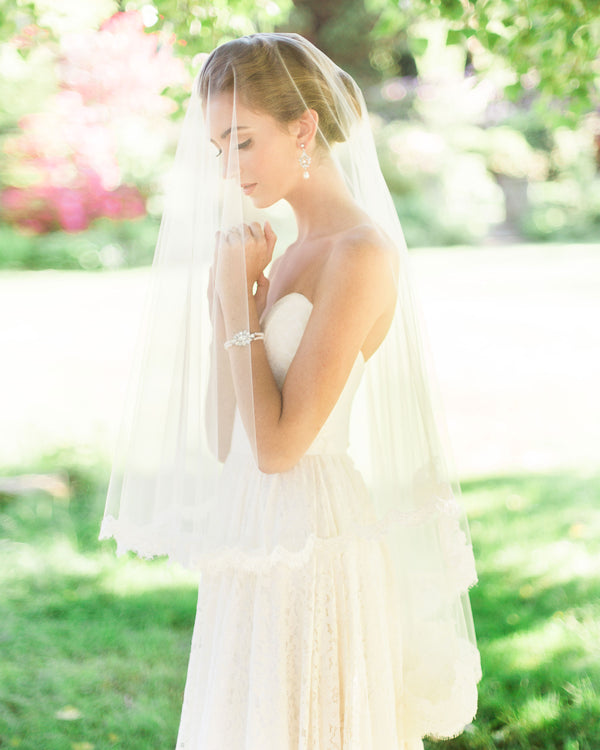 model wearing amara lace fingertip wedding veil