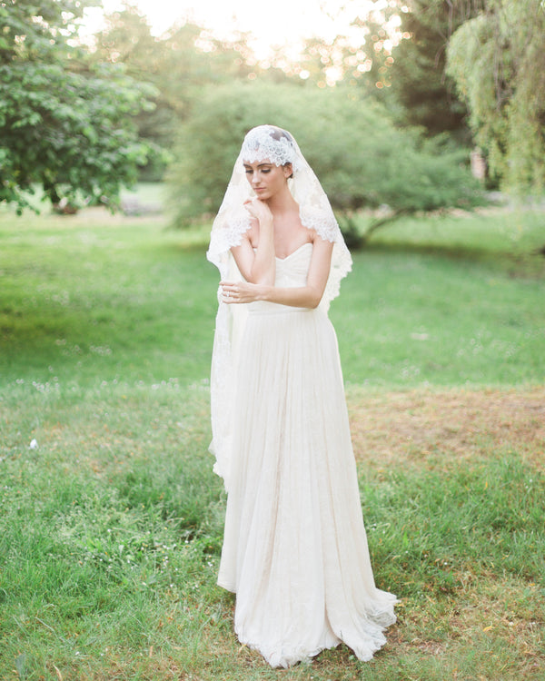 model wearing Analina chantilly lace mantilla veil