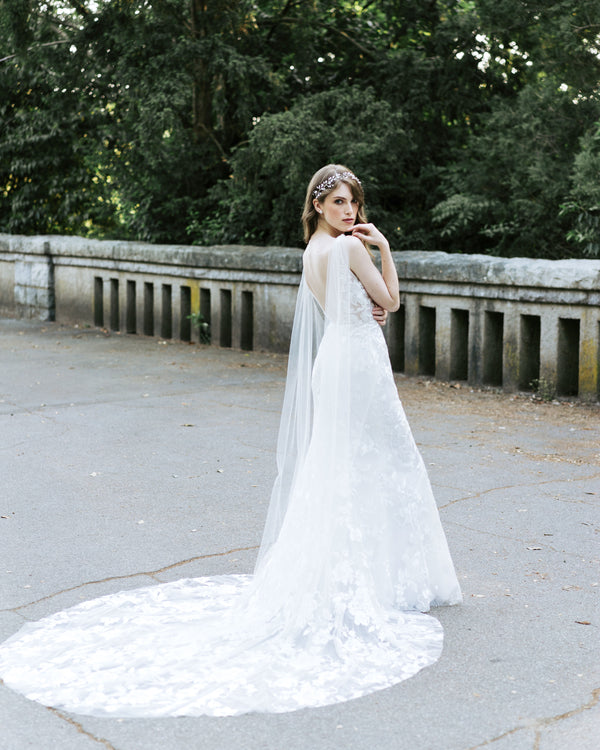 Model wearing Aster cape bridal veil