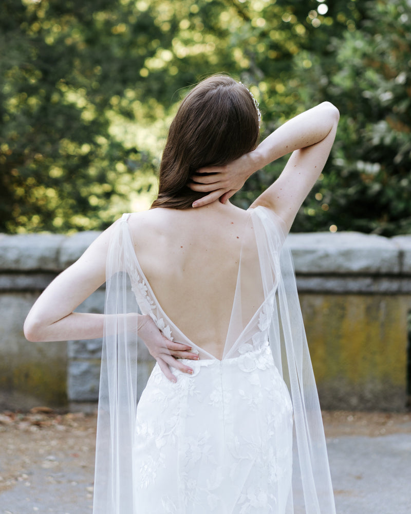 Model wearing Aster cape wedding chapel veil