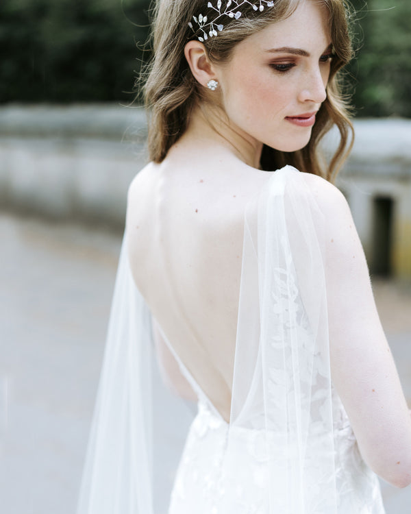 Model wearing Aster cape bridal chapel veil