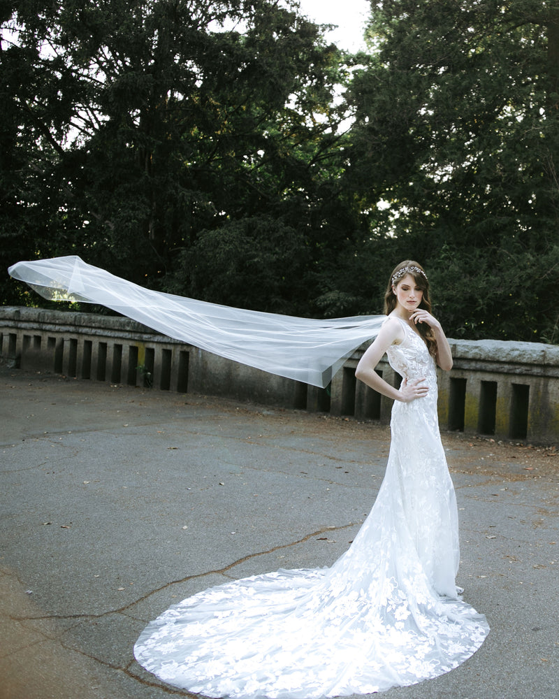 Model wearing Aster cape chapel veil