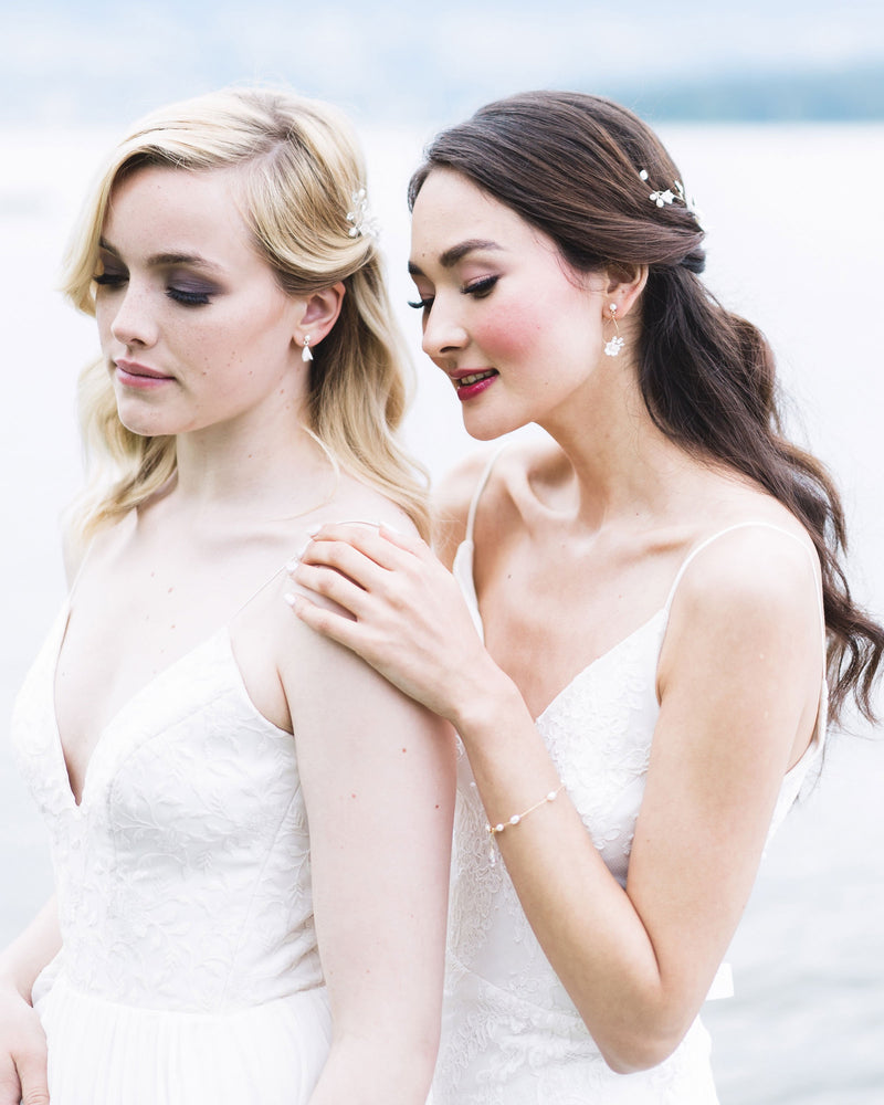 Models wearing the swarovsiki crystal and freshwater pearl Belle Fleur Earrings and Belle Fleur Petite Earrings