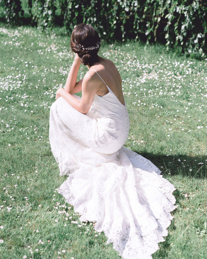 Model wearing the Belle Fleur Grand gold Bridal hair Comb by Atelier Elise with low back dress
