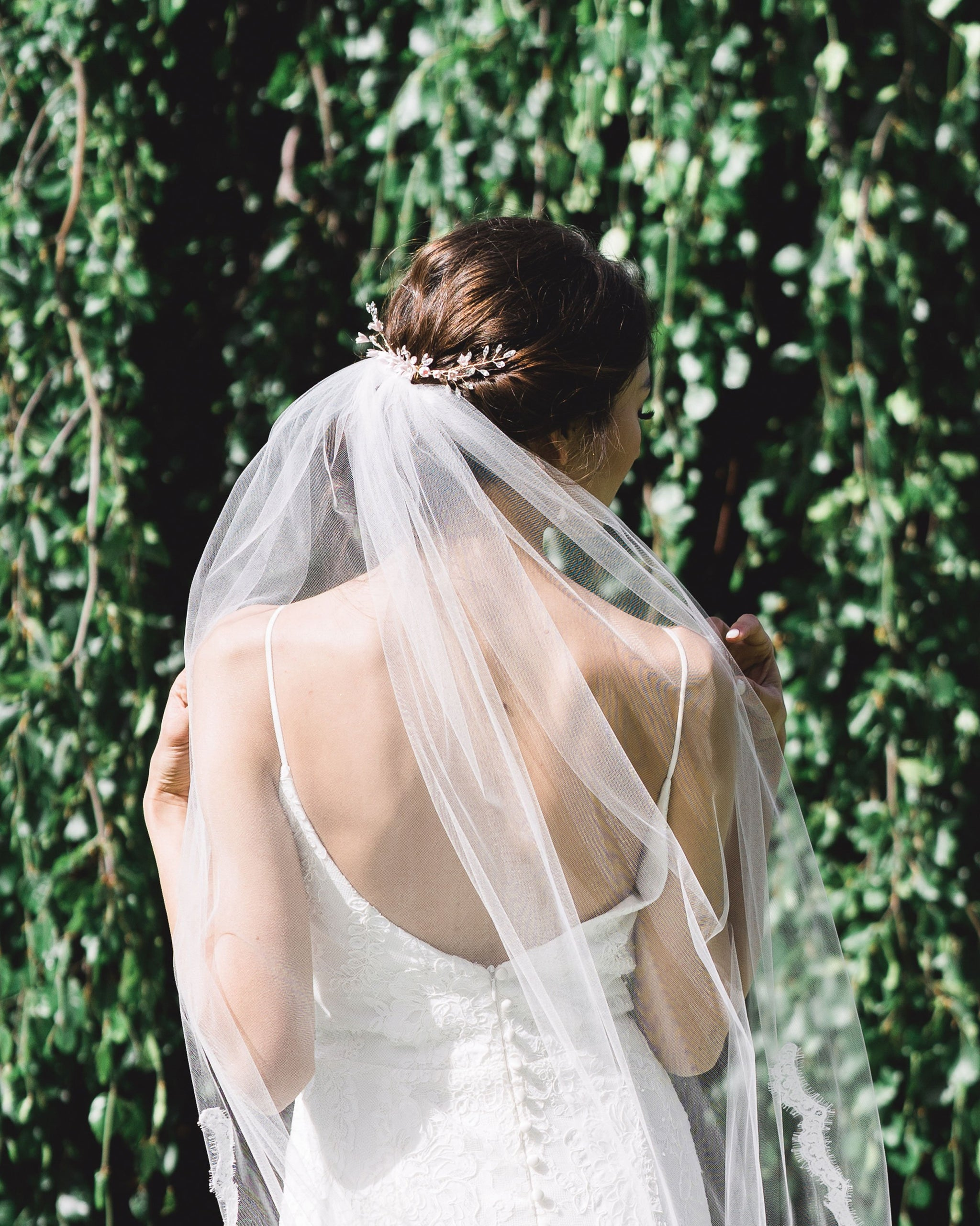 Belle Fleur Grand Bridal Comb by Atelier Elise styled with a low updo above a tulle veil