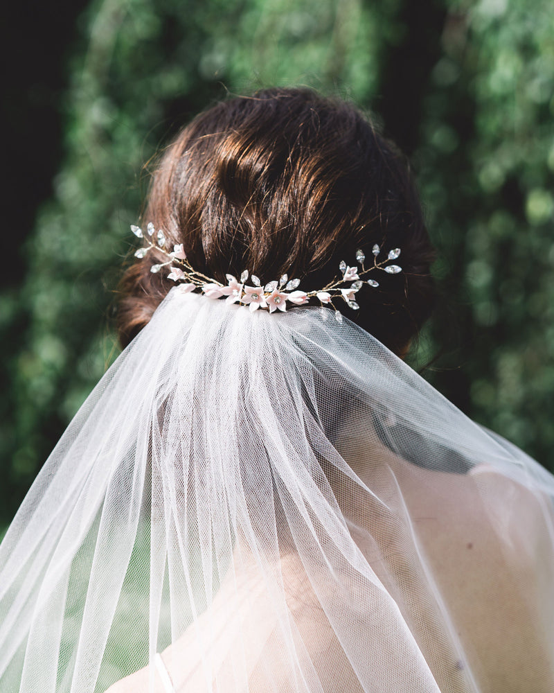 Belle Fleur Grand Bridal hair Comb by Atelier Elise styled with a low bun updo above a tulle veil