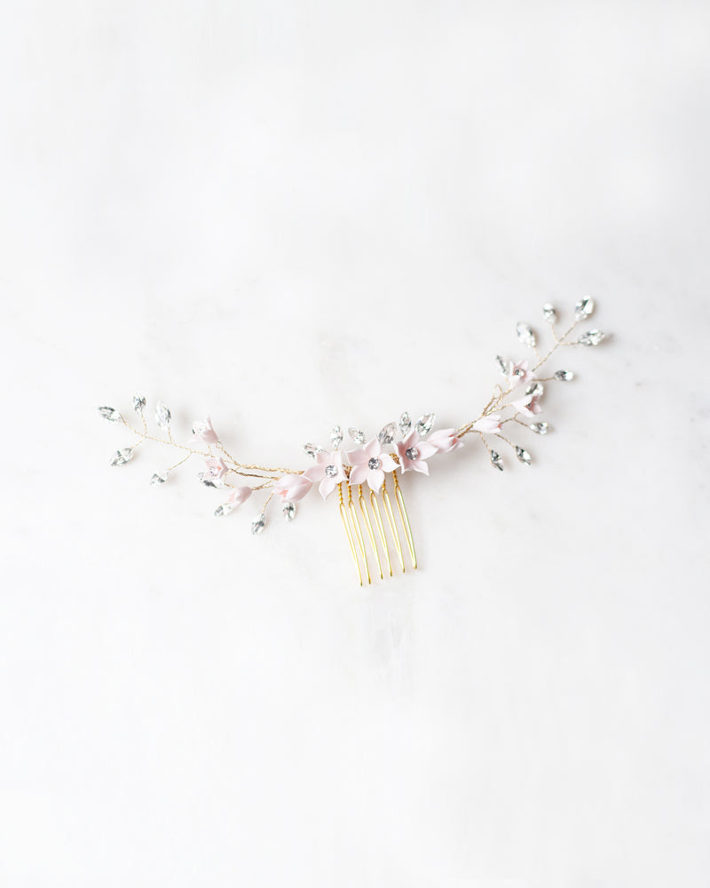 flat lay of the Belle Fleur Grand gold hair Comb by Atelier Elise, made of delicate flowers, swarovski crystals, and freshwater pearls.