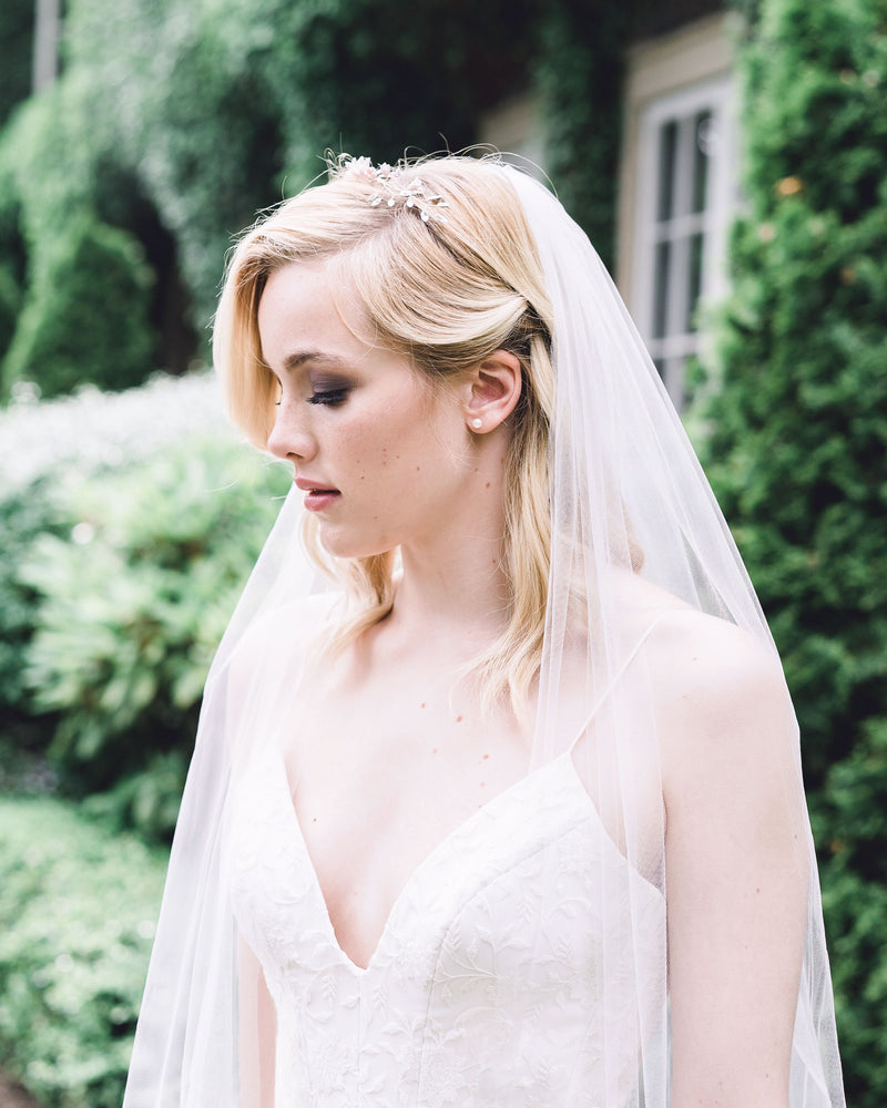 Model wearing bridal accessories, the Belle Fleur Grand Bridal hair Comb as a crown with an airy tulle veil.